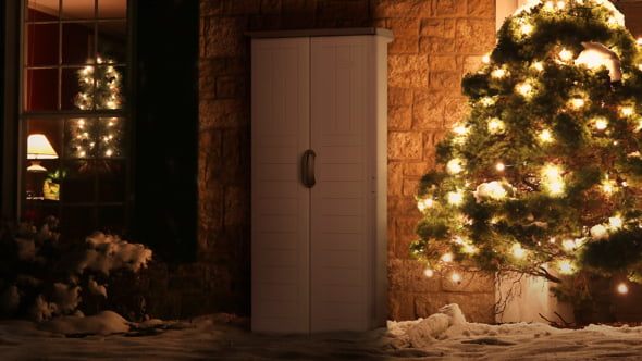 Outdoor storage next to a lighted tree