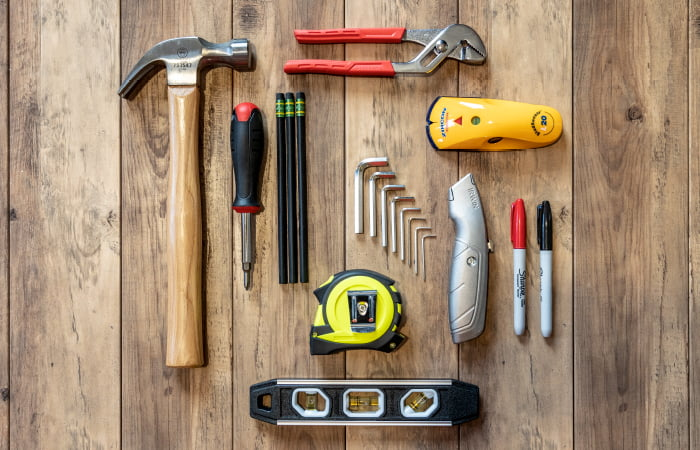 Tools arranged on wooden boards