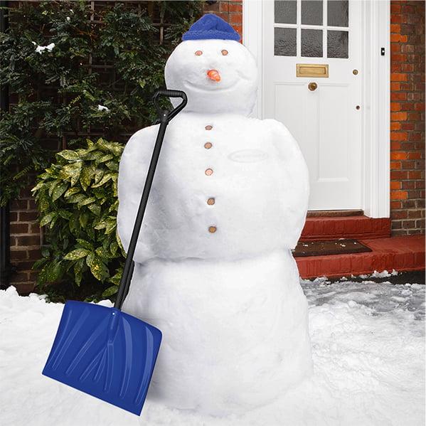 Snowman with snow shovel