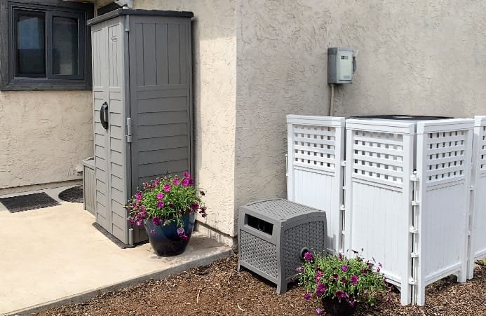 Outdoor screen enclosure covering up an AC unit.