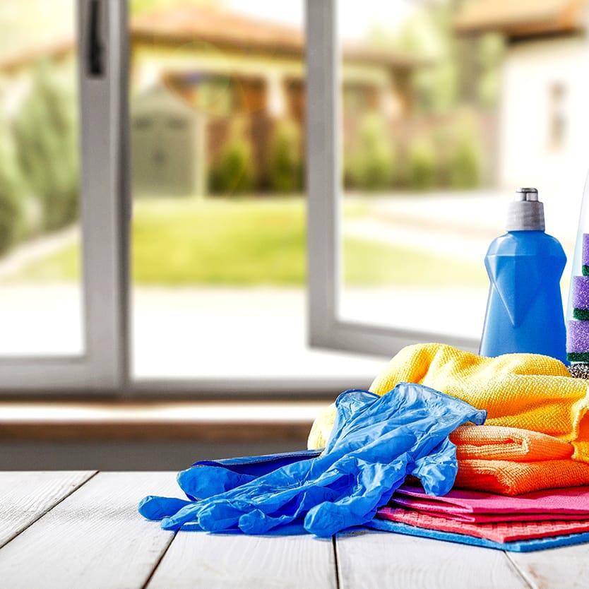Cleaning supplies on floor next to open exterior door