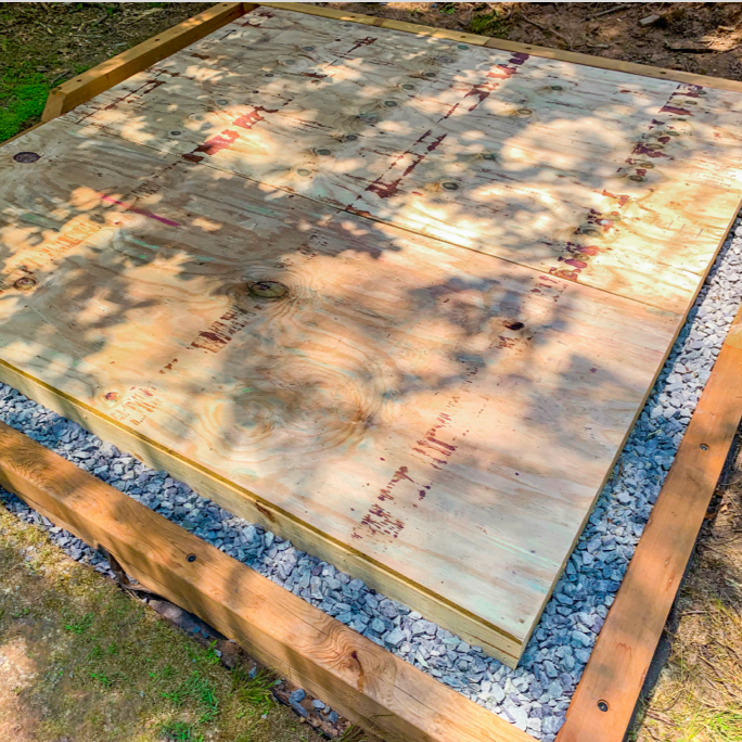 Gravel foundation with wooden base on top