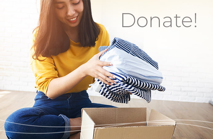 Woman boxing up donations